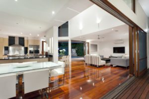 Luxurious, modern home interior with large sliding doors