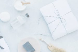 White marble background with white towel, soap and other products