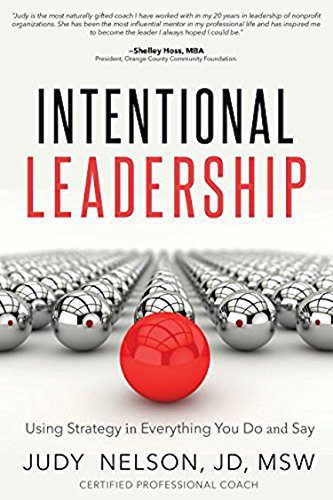 Book on Intentional Leadership, white background silver and red ball bearings on front cover of book