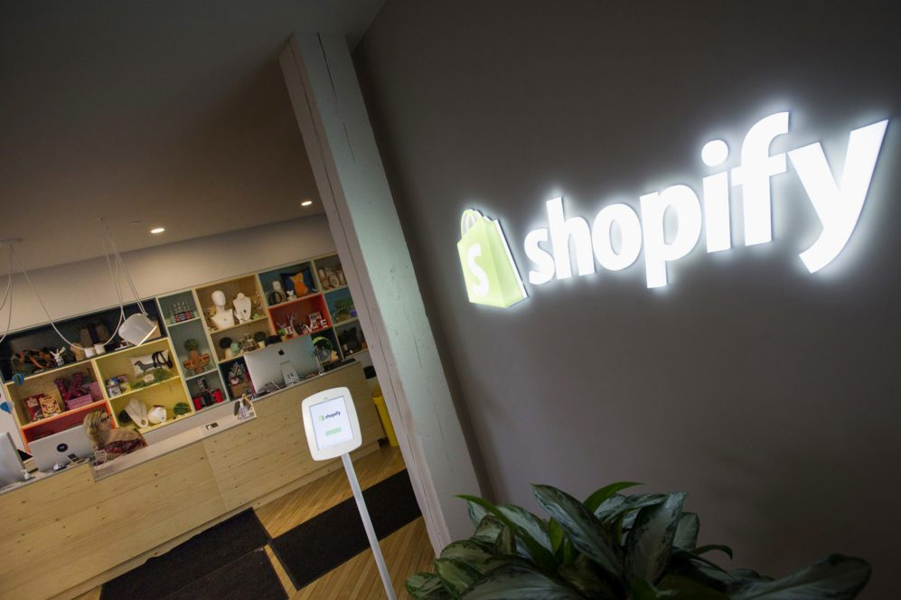 Shopify Inc. signage is seen at the entrance to the company's headquarters in Toronto, Ontario, Canada. Photographer: Kevin Van Paassen/Bloomberg