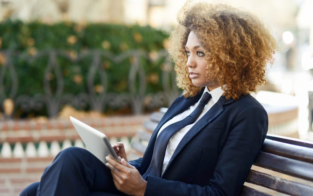Beautiful business woman uploading article to LinkedIn